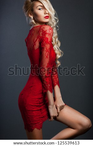 beautiful fashionable woman in red dress - stock photo