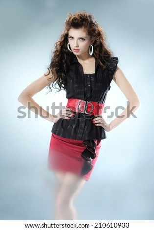 Beautiful fashionable woman posing on light background - stock photo