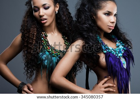 beautiful fashionable woman with blue decoration - stock photo