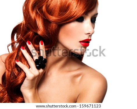 Beautiful fashionable woman with red nails and red hairs. Portrait of a fashion model with bright eye makeup -   isolated on white. - stock photo