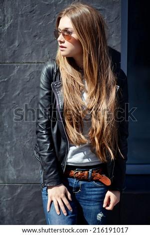 Beautiful fashionable young woman - stock photo