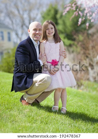 Beautiful father and daughter outdoor portrait in spring - stock photo