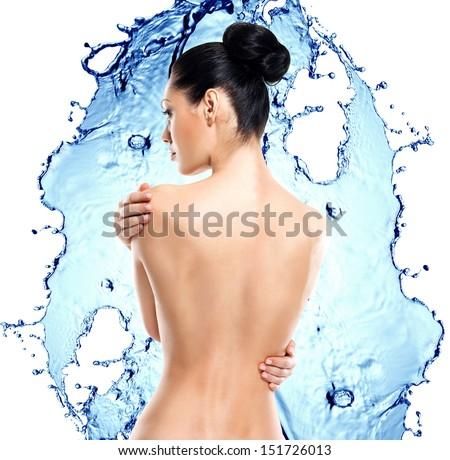 Beautiful female back over water splash background. Back view portrait - stock photo