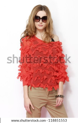 Beautiful female blonde fashion model in red dress isolated - stock photo