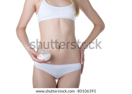 Beautiful female body isolated on white background. Sexy young woman in white panties. applying moisturizer cream on body legs. Perfect female figure. Body beauty concept. - stock photo