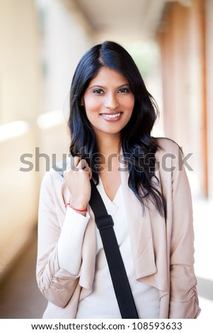 beautiful female college student with shoulder bag - stock photo