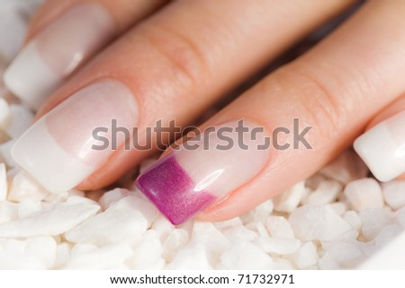 beautiful female colored fingernails in pink and white - stock photo