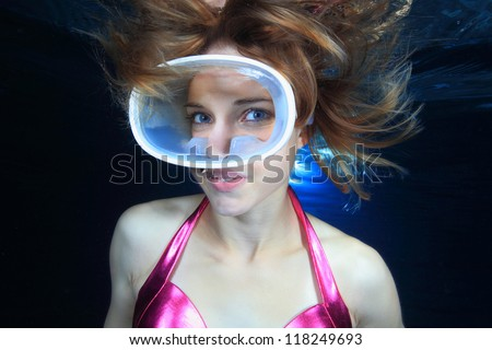 Beautiful female diver - stock photo