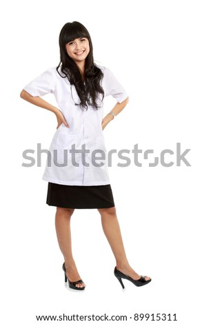 Beautiful Female doctor standing alone in white background - stock photo