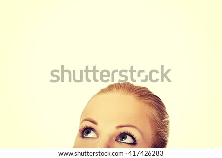 Beautiful female eyes looking up for copyspace or something - stock photo