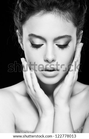 beautiful female face with natural makeup, on black background - stock photo