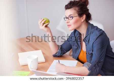 Beautiful female freelancer has a lot of work - stock photo