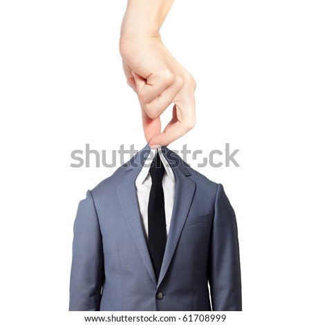 Beautiful female hand holding a gray suit with a tie against white background - stock photo