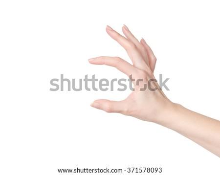 Beautiful female hand holding something - stock photo