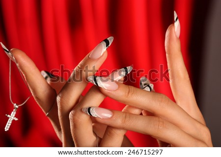 Beautiful Female Hands. Beautiful hand with perfect nail. Manicure.  Colourful Nail polish. Colourful nails. - stock photo