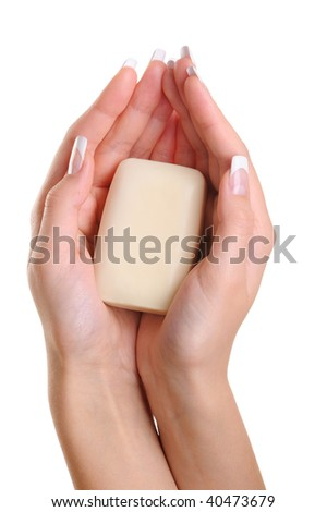 Beautiful female hands hold the white soap - over white background - stock photo