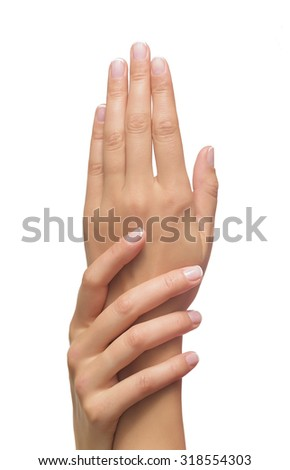 Beautiful female hands isolated on a white background - stock photo