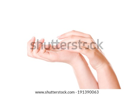 Beautiful female hands with french manicure. - stock photo