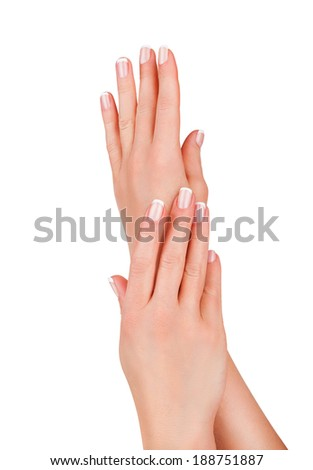 Beautiful female hands with french manicure isolated on white background - stock photo