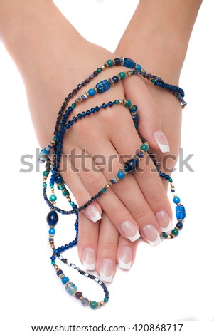 Beautiful female hands with manicure isolated on white background - stock photo