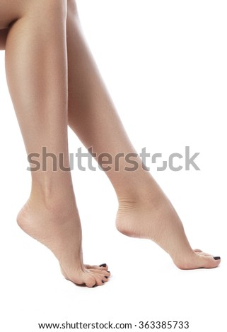 Beautiful female legs after depilation. Healthcare, foot care, rutine treatment. Spa and epilation. Sexy shape of woman's body. Part of female body. Feet with perfect clean smooth skin and pedicure. - stock photo