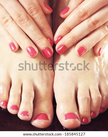 Beautiful female legs and hands with a manicure  - stock photo