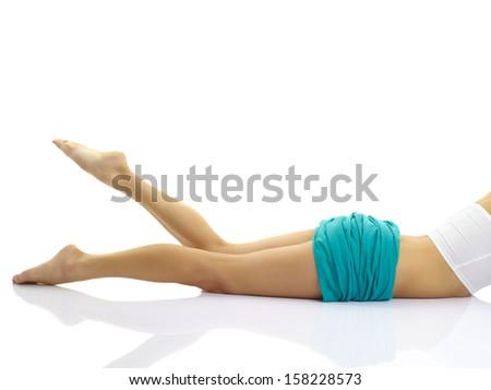 Beautiful female legs at white background - stock photo