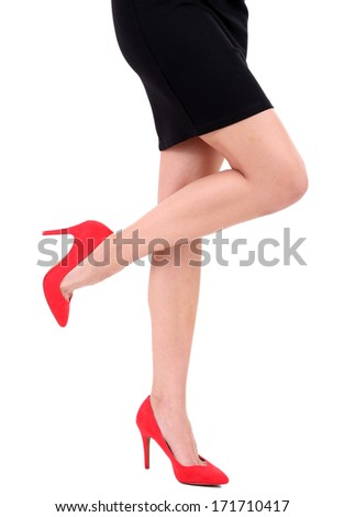 Beautiful female legs in red shoes isolated on white - stock photo