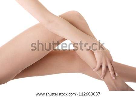 Beautiful female legs touched by hand - stock photo