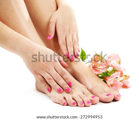 Beautiful female legs with flowers, isolated on white background - stock photo