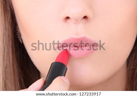 beautiful female lips with red lipstick - stock photo