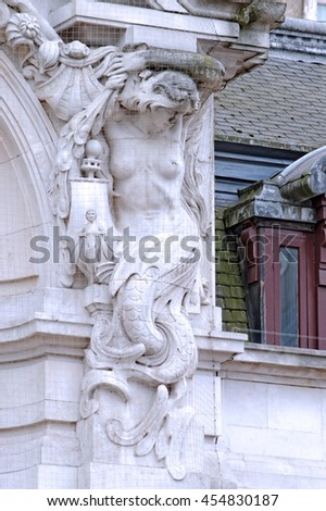 Beautiful female mermaid statue on building facade, Westminster, London - stock photo