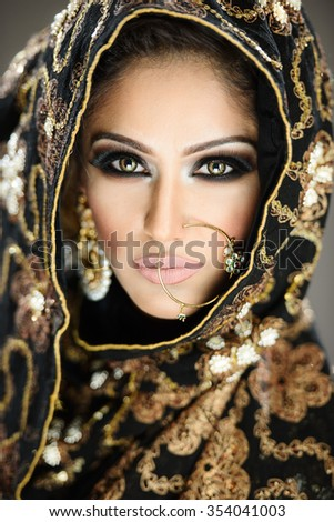 Beautiful female model bride in ethnic bridal costume and jewellery - stock photo