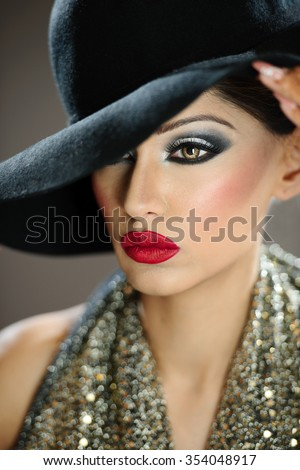 Beautiful female model with makeup wearing a hat - stock photo