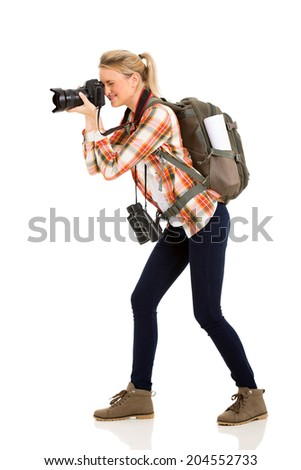 beautiful female tourist taking photos with digital camera - stock photo