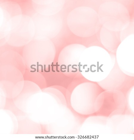 Beautiful festive glowing sparkly soft pink red unfocused bokeh style abstract background. - stock photo
