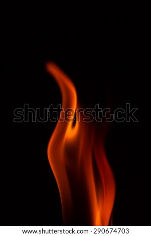 Beautiful fire flames, isolated on black background, - stock photo