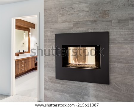Beautiful fireplace and bathroom view in luxury home - stock photo