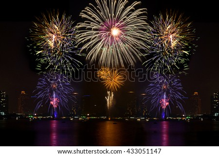Beautiful firework display for celebration on the river, colorful fireworks for independence day. - stock photo