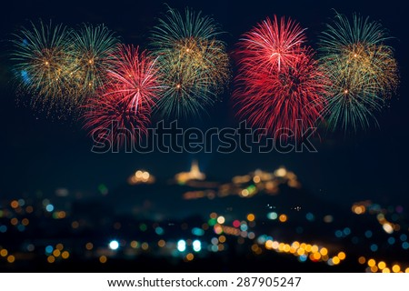 Beautiful firework display for celebration with blur bokeh light background - stock photo
