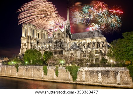 Beautiful firework over Notre Dame cathedral in Paris, France - stock photo