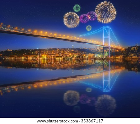 Beautiful fireworks and cityscape with Galata Tower, Golden Horn and ferry wirh beautiful fireworks in Istanbul, Turkey - stock photo