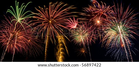 Beautiful fireworks display lights up the night time sky - stock photo