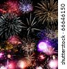 Beautiful fireworks exploding over a dark night sky in a grand finale display.  Very high resolution. - stock photo