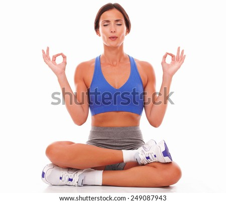 Beautiful fit lady relaxing through yoga on isolated background - stock photo