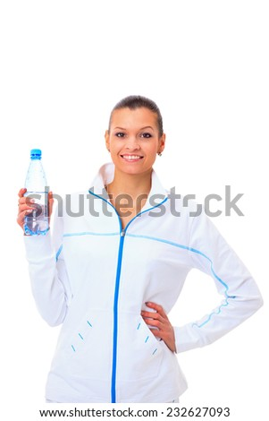 Beautiful fit mixed race female model holding a bottle of water - stock photo