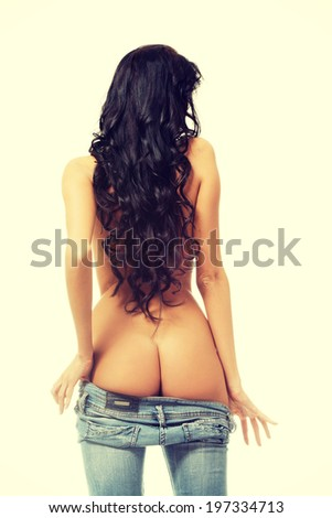 Beautiful fit sexy woman in blue jeans. - stock photo