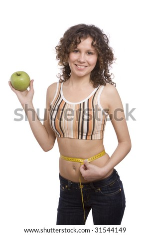 Beautiful fit woman with measure tape isolated over white. Weight loss and healthy lifestyle concept. Girl measuring waist with a tape measure. Woman hold apple in hand. Isolated - stock photo