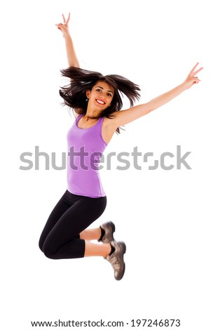 Beautiful fit young lady jumping enjoying her healthy life. - stock photo