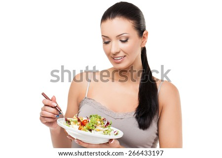 Beautiful fit young woman hold plate with fresh salad. Isolated over white background - stock photo